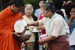 Give food offerings to a Buddhist monk Royalty Free Stock Photography