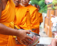 Give food offerings to a Buddhist monk Stock Images