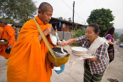Give food offerings to a Buddhist monk in Morning Stock Images