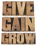 Give, gain and grow. Personal development or motivational concept - isolated word in vintage letterpress wood type printing blocks Stock Photos