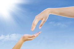 Give gesture under blue sky Stock Photos