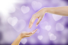 Give gestures on purple defocused lights Royalty Free Stock Photos