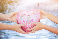 Give the gift box. Give the gift on the eve of the festival with copy space Royalty Free Stock Photos