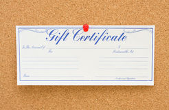 Give a Gift Certificate. A gift certificate tacked to a corkboard, give a gift certificate royalty free stock image