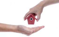 Give House to hand Stock Images