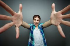 Give a hug. Crazily looking man wanting to give a hug, april fools day series stock photography