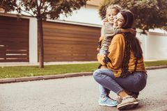 Give a hug to Mother. Mother and daughter share love. Lifestyle royalty free stock image