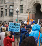 Give Kids a Pollution Solution. A child holds a sign at a rally in Salt Lake City, Utah Royalty Free Stock Photo