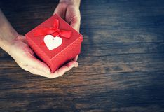 Give Love Man holding small red present box in hands with Heart for love Valentines day concept stock photography