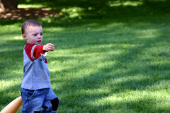 Give me the Ball. Little Boy playing baseball - asking for the ball stock images