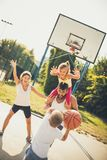 Give me a ball. Family playing basketball stock images