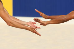 Give me five. Hands of a beach volley players celebrating a point stock image