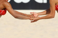 Give me five. Hands of a beach volley players celebrating a point royalty free stock photos