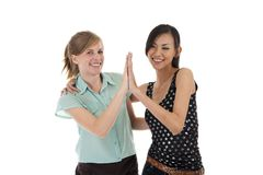 Give me five. High-Five between caucasian and asian woman, isolated on white background royalty free stock images