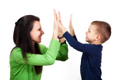 Give me five. Mother and son slap hands with feeling of success and victory stock photos
