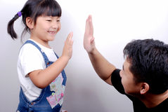 Give me five. Adult and child stock photography