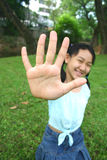 Give me five!. Asian girl showing her hand stock image