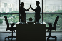 Give me five. Business colleagues giving high five after successful work royalty free stock photography
