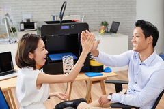 Give me five. Coworkers giving each other high five after working on 3D model royalty free stock photos