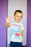 Give me five. Cute blond smiling 5 years old Child at home royalty free stock images
