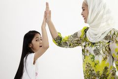 Give me five. Mother and daughter royalty free stock images