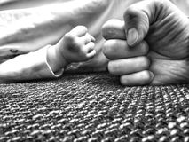 Give me five. Hand hands fingers child blackandwhite family royalty free stock photo