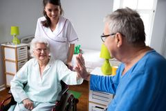 Give me five, see you later eldrly friend. Funny old people at nursing home royalty free stock images