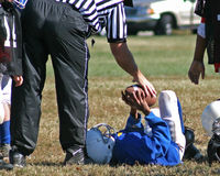 Give Me The Football. Referee taking football from downed player Stock Images