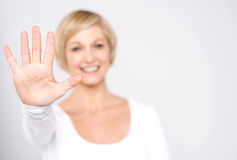 Give me high five gesture. Smiling woman making high five with her hand stock image
