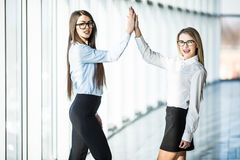 Give me high-five. Two business women giving high-five of good work. Royalty Free Stock Photography