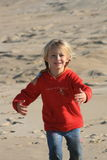 Give me a hug!. A beautiful white caucasian girl child running to her mom to give her a hug royalty free stock image