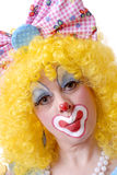 Give me a kiss. Closeup of female clown with bow in her hair giving a kiss to the camera Royalty Free Stock Image