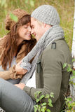Give me a kiss. Happy couple together in the wood Stock Image