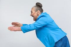 Give me money! Aged woman stretches for coin Royalty Free Stock Photography