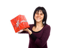 Give me a present. Young woman giving or receving a red present Royalty Free Stock Photography