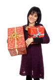Give me a present. Happy young woman with presents Stock Photography