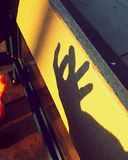 Give me your hands. Waiting for the bus on a Friday evening.  The sun going down reflecting it& x27;s beautiful golden rays on me and everything around. So, I Stock Image