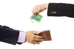 Give money from businessman to another Royalty Free Stock Photo