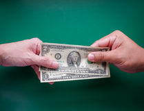 Give money. Hand give money Take a debt Share borrow money Stock Photography