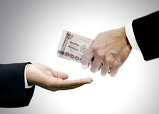 Give money to brokers. Concept Stock Photography