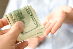 Give money to someone as bribe to suggest a corrupt system. Give money to someone in exchange of favors as bribe to suggest a corrupt system Royalty Free Stock Image