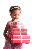 Give presents! Curly mulatto girl with gift boxes in hands on a white background Stock Photos