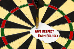 Give Respect Earn Respect. Darts with dart which was pinned a sh. Give Respect Earn Respect. Darts with dart arrow which was pinned a sheet of paper for labels Royalty Free Stock Photography