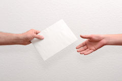 Give someone money in envelop Royalty Free Stock Image