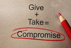 Give and Take Compromise. Text on paper with pencil royalty free stock image