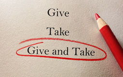 Give and Take Compromise. Give and Take red pencil circle on textured paper -- compromise concept Stock Images