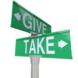 Give and Take Double Road Signs Greedy or Charitable Royalty Free Stock Images