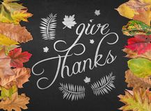 Give Thanks design quote postcard banner with autumn leaves. Background stock images
