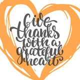 Give thanks with a grateful heart - Thanksgiving day lettering calligraphy phrase. Autumn greeting card isolated on the Stock Photos
