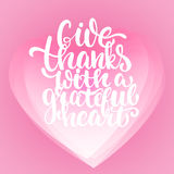 Give thanks with a grateful heart - Thanksgiving day lettering calligraphy phrase. Autumn greeting card on the white. Background with transparency pink hearts Stock Photography